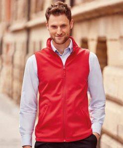 Man wearing red softshell gilet
