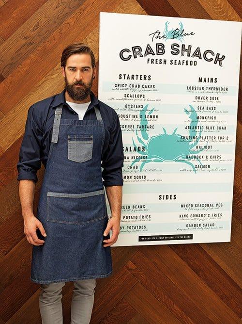 Waiter wearing blue denim contrast apron